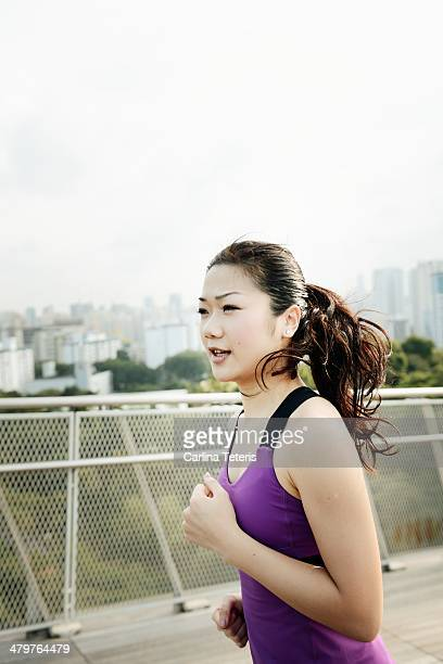 Chinese woman running in urban park