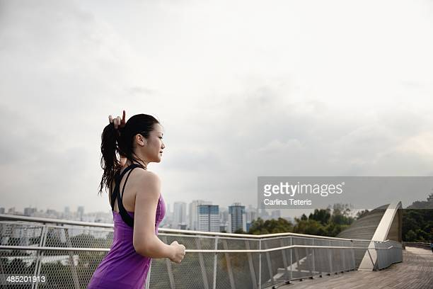 Chinese woman running on Henderson Wave Bridge