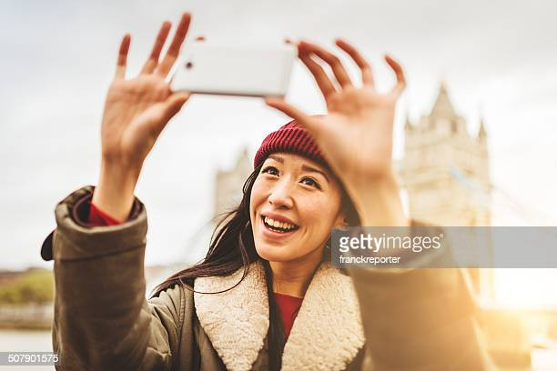 chinese woman self photographing in London