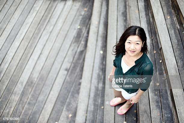 Chinese woman standing on wooden steps
