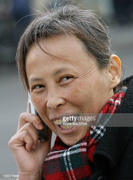 A Chinese woman uses her GPRS technology mobile phone on the streets of Shanghai 29 January 2007 China has launched a trial run of homegrown...