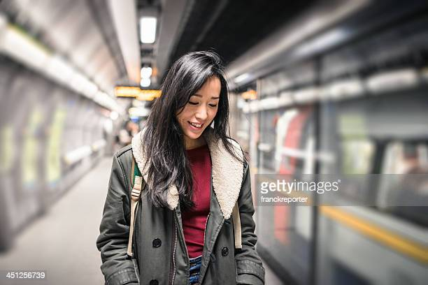 Chinese Woman waiting the metro