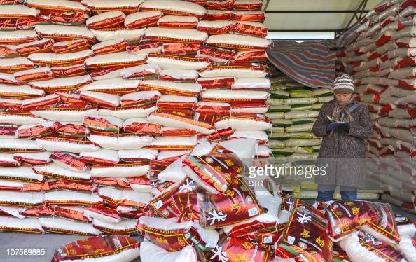 A Chinese woman writes down her sales records at a food market in Beijing on November 16 2010 China's central bank governor on voiced concern at...