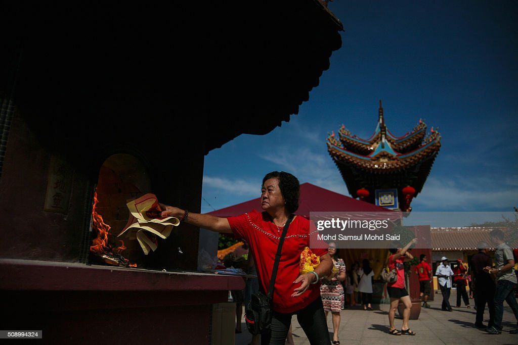 A Chinese women burning the yellow paper as her offer a prayer inside the Guan Yin temple during Lunar New Year of the monkey celebrations on February 8, 2016 outside Kuala Lumpur, Malaysia. According to the Chinese Calendar, the Lunar New Year which falls on February 8 this year marks the Year of the Monkey, the Chinese Lunar New Year also known as the Spring Festival is celebrated from the first day of the first month of the lunar year and ends with Lantern Festival on the Fifteenth day.
