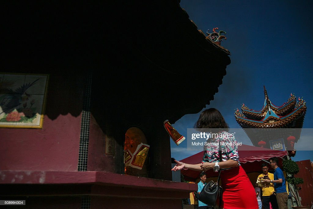 A Chinese women burning the yellow paper inside the Guan Yin temple as her offer a prayer during Lunar New Year of the monkey celebrations on February 8, 2016 outside Kuala Lumpur, Malaysia. According to the Chinese Calendar, the Lunar New Year which falls on February 8 this year marks the Year of the Monkey, the Chinese Lunar New Year also known as the Spring Festival is celebrated from the first day of the first month of the lunar year and ends with Lantern Festival on the Fifteenth day.