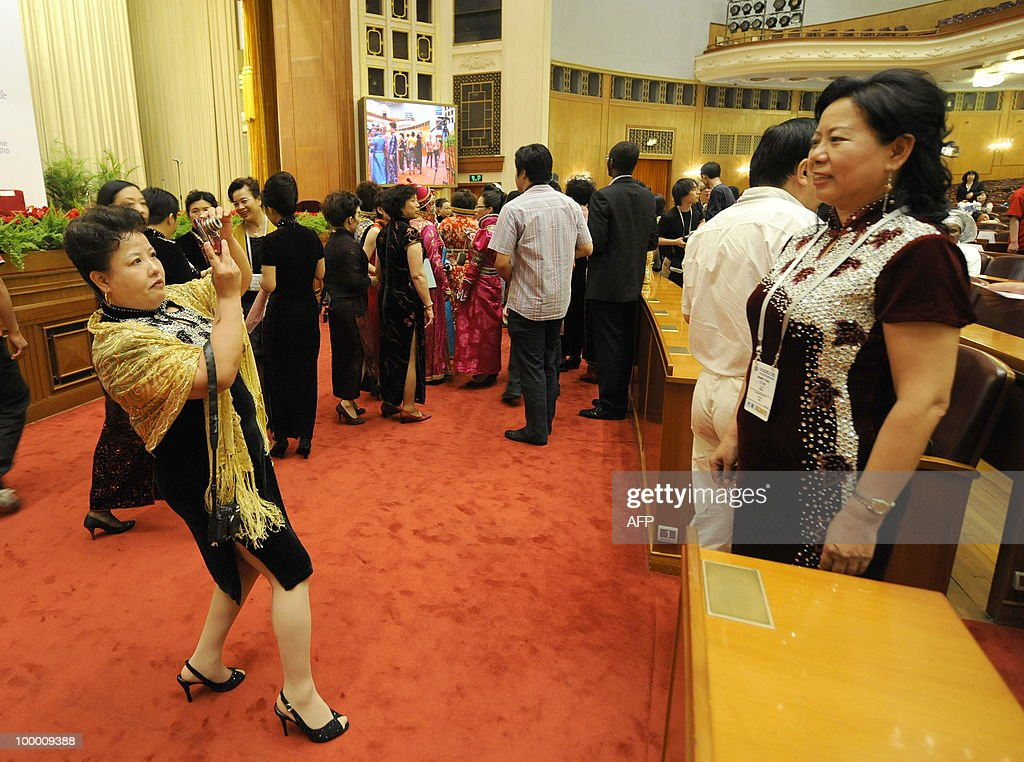 Chinese women delegates take photos of each others before the opening ceremony of the 20th Global Summit of Women at the Great Hall of the People in Beijing on May 20, 2010. More than 1,000 women delegates from 80 countries participate in the Global Summit of Women in China's capital from May 20-22, 2010. AFP PHOTO/LIU Jin