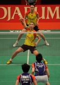 Chinese women double Cheng Shu and Bao Yixin return the shuttlecock against Chinese compatriots Yu Yang Wang Xiaoli during the Djarum Indonesia Open...