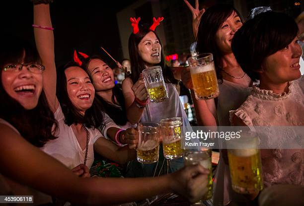 Chinese women drink beer during the 24th Annual Qingdao International Beer Festival on August 20 2014 in Qingdao China The city is home to Chinese...