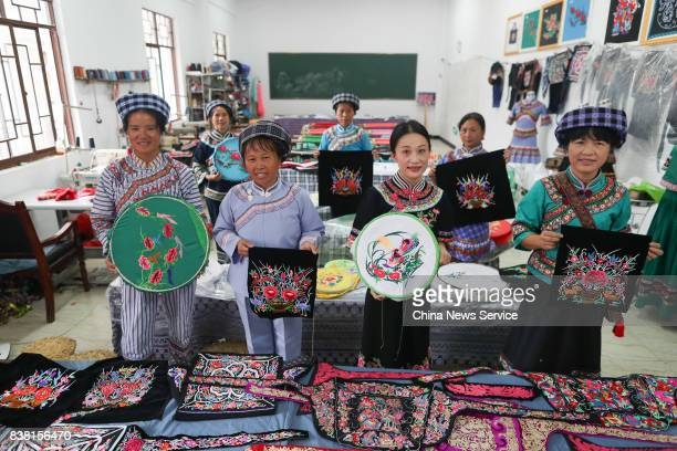 Chinese women of Bouyei ethnic group show the embroidery at Wangmo County on August 24 2017 in Qianxinan Bouyei and Miao Autonomous Prefecture...
