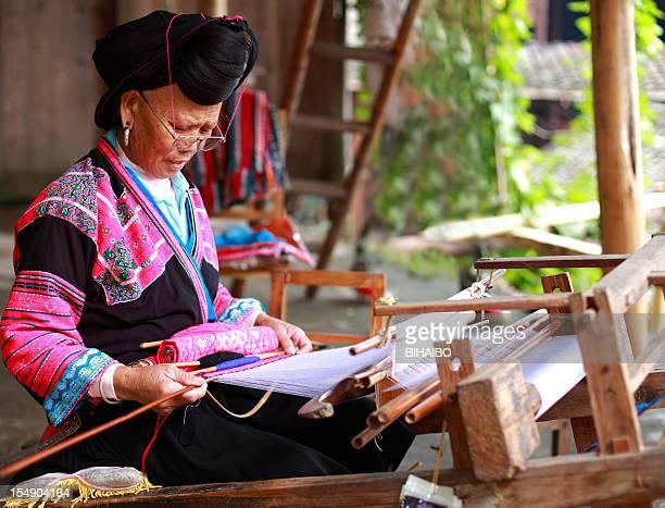 Chinese women weaving
