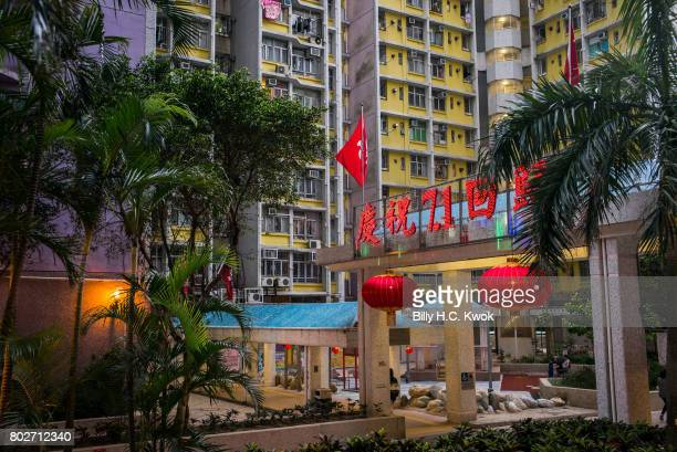 Chinese words 'Celebrating 20th anniversary of handover' are seen illuminated at the public estate ahead of 20th anniversary of the handover from...