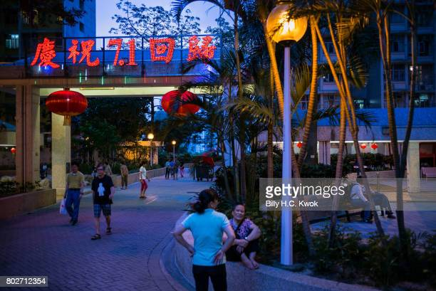 Chinese words 'Celebrating 20th anniversary of handover' are seen illuminated at night at the public estate ahead of Chinese President Xi Jinping's...