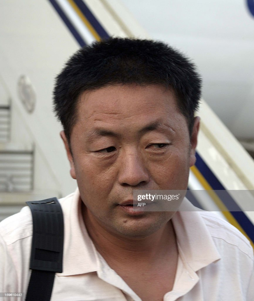 A Chinese worker abducted by Darfur rebels earlier this month, arrives at the Khartoum airport after his release on January 17, 2013. Four Chinese workers abducted by Darfur rebels on January 12 have been freed, a spokeswoman for the joint UN-African Union peace keeping force in the troubled western Sudan region.