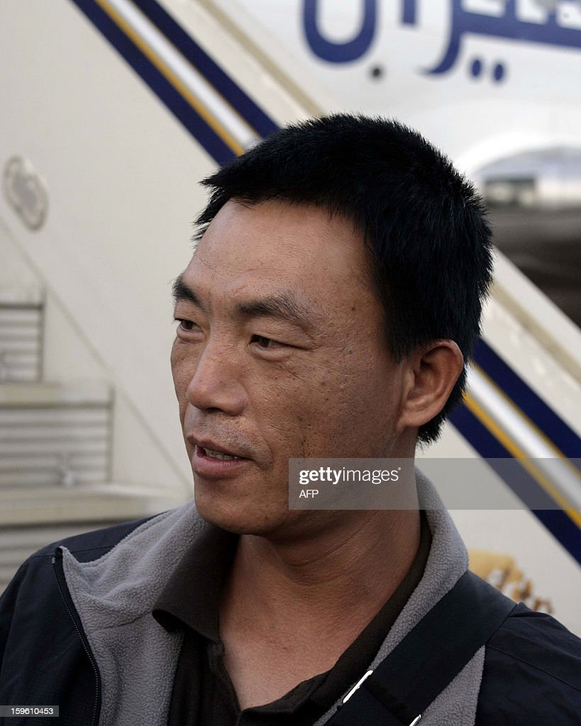 A Chinese worker abducted by Darfur rebels earlier this month, arrives at the Khartoum airport after his release on January 17, 2013. Four Chinese workers abducted by Darfur rebels on January 12 have been freed, a spokeswoman for the joint UN-African Union peace keeping force in the troubled western Sudan region. AFP PHOTO / EBRAHIM HAMID