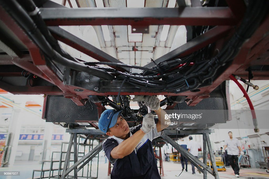A Chinese worker assembles a hybrid bus at a factory of Chinese auto manufacturer Beiqi Foton Motor Co., Ltd on September 11, 2009 in Beijing, China. A according to reports, China is expected to be a leader in the new-energy automobile industry in the future as the country puts efforts and money into research and new technology.