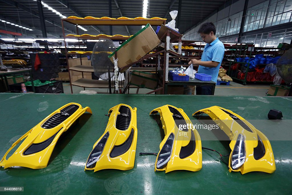 A Chinese worker assembles toy cars at a toy factory in Jinjiang, southeast China's Fujian province on July 1, 2016. Activity in Chinese factories suffered its sharpest deterioration for four months in June, figures showed on July 1, as weak demand and industrial overcapacity weighed on the world's second-largest economy. / AFP / STR / China OUT
