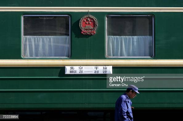 Chinese worker checks a train from Beijing to Pyongyang at the railway station on October 20 2006 in the Chinese border city of Dandong Liaoning...