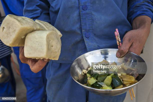 A Chinese worker display his meal for a photograph during a break at the Sindh Engro Coal Mining Co site in the Thar desert Pakistan on Thursday...