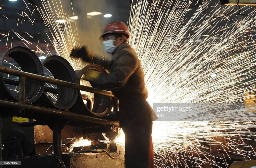 A Chinese worker goes about his chores at a steel mill in Hefei, in eastern China's Anhui province on December 23, 2010. A top US trade official expressed concern over a 'troubling trend' toward Chinese state intervention in the economy, and while lauding the 'many impressive steps' China has taken to reform its economy in the nine years since it joined the WTO, an annual report sent to Congress paints a picture of a reform movement that ran aground in the middle of the last decade. CHINA