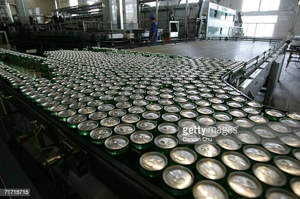 Chinese worker monitors the can lines of the Tsingtao beer factory on August 25 2006 in Qingdao Shandong Province of China Tsingtao Beer Group...