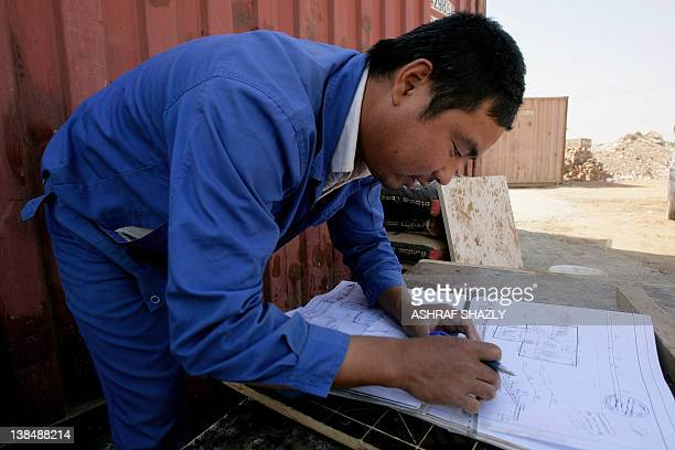 A Chinese worker prepares a map at a construction site in the Sudanese capital Khartoum on February 2 2012 Africa where China has emerged as a major...