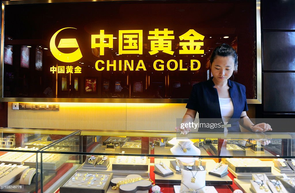 A Chinese worker waits for customers at a gold shop in Beijing on August 4 2010 China has moved to further free up the nation's gold market by...
