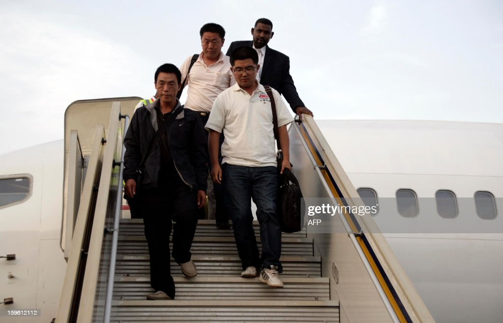 Chinese workers abducted by Darfur rebels earlier this month, arrive at the Khartoum airport after their release on January 17, 2013. Four Chinese workers abducted by Darfur rebels on January 12 have been freed, a spokeswoman for the joint UN-African Union peace keeping force in the troubled western Sudan region. AFP PHOTO / EBRAHIM HAMID