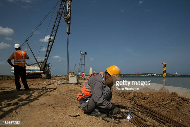 Chinese workers are seen building the Mahida Rajapaksa Port in Hambantota July 6 2013 War's end has unleashed Sinhalese nationalism that has Tamils...