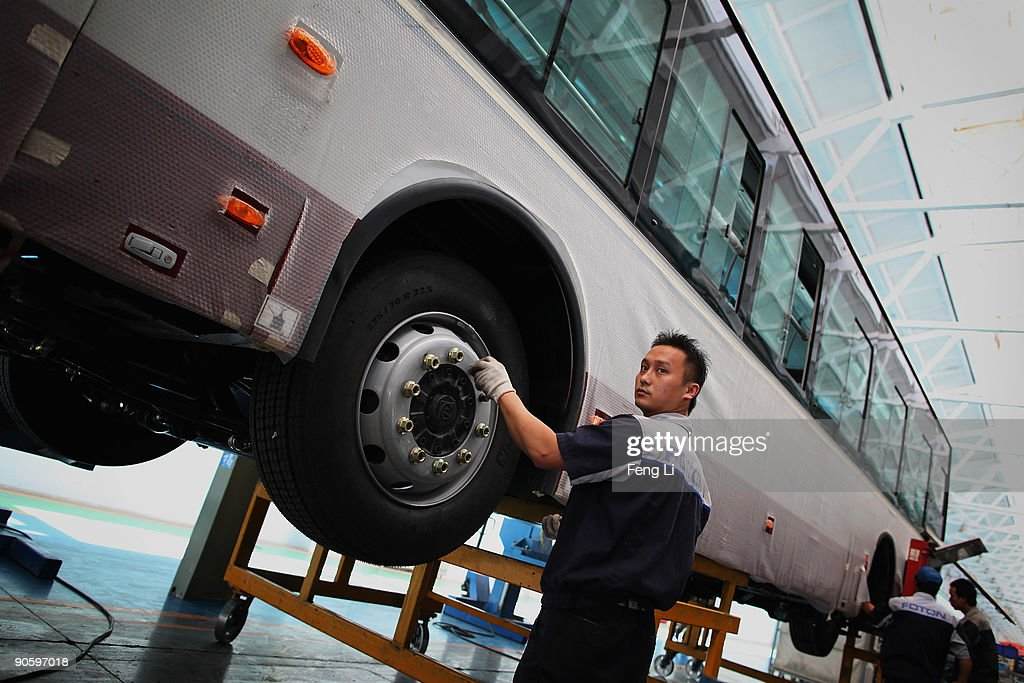 Chinese workers assemble a hybrid bus at a factory of Chinese auto manufacturer Beiqi Foton Motor Co., Ltd on September 11, 2009 in Beijing, China. A according to reports, China is expected to be a leader in the new-energy automobile industry in the future as the country puts efforts and money into research and new technology.