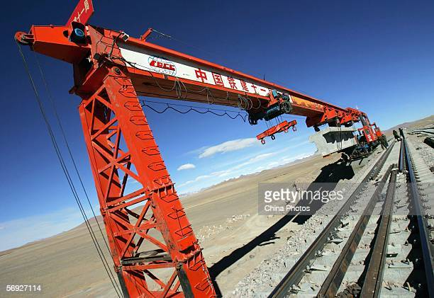 Chinese workers lay tracks at a construction site of the QinghaiTibet Railway on February 24 2006 in Anduo County of Tibet Autonomous Region China...
