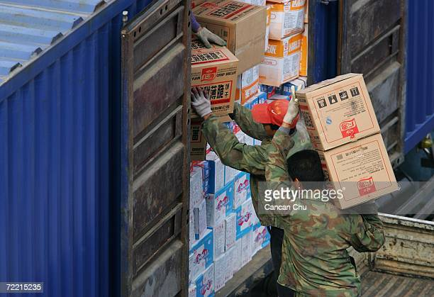 Chinese workers load goods on to North Korean Vehicles on October 19 2006 in the Chinese border city of Dandong Liaoning Province of China Customs...