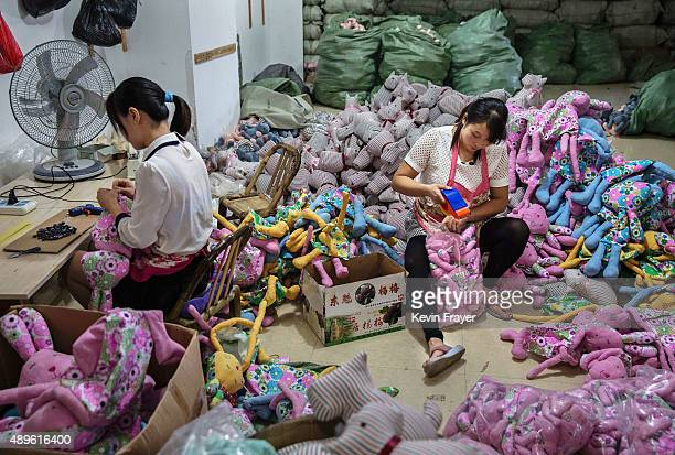 Chinese workers prepare stuffed toys at a factory on September 17 2015 in Zhejiang China Many of the toy factories in the area have seen a sharp...