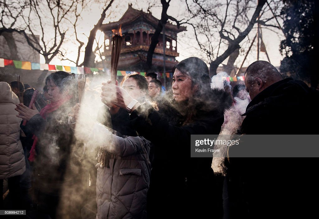 Chinese worshippers hold incense and pray at the Yongchegong Lama Temple on February 8, 2016 in Beijing, China. The Chinese Lunar New Year also known as the Spring Festival, which is based on the Lunisolar Chinese calendar, is celebrated from the first day of the first month of the lunar year and ends with Lantern Festival on the fifteenth day.