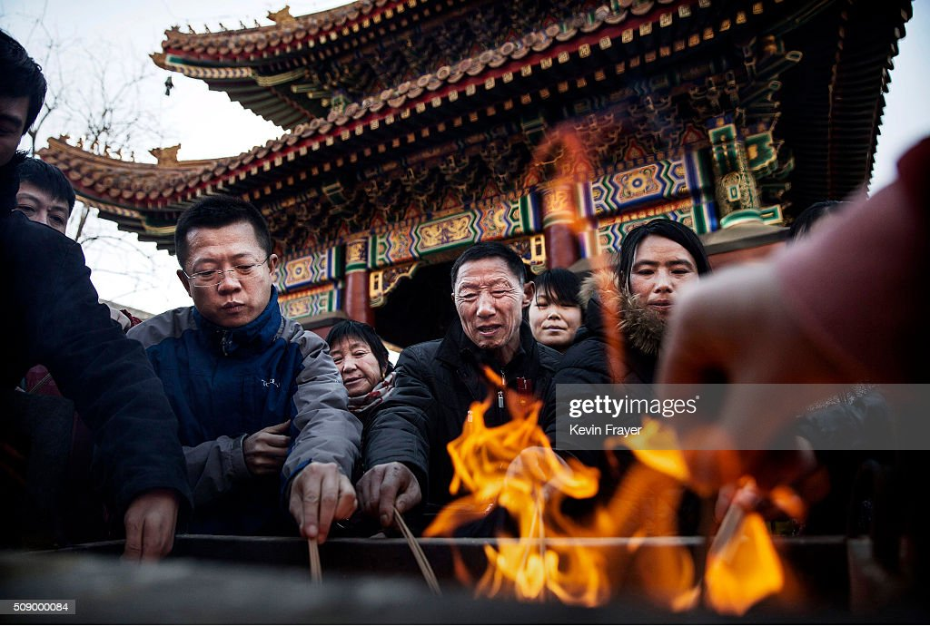 Chinese worshippers light incense as they pray at the Yongchegong Lama Temple on February 8, 2016 in Beijing, China. Chinese New Year is being celebrated around the world, marking the beginning of the year of the Monkey. The New Year, also known as the Spring Festival, is celebrated from the first day of the first month of the Chinese lunar calendar and ends with the traditional Lantern Festival on the Fifteenth day.