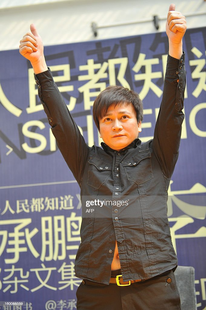 Chinese writer Li Chengpeng, looked upon by many as a a highly influential Chinese blogger and social commentator, attends a promotional event of his new book 'SmILENCE' on January 26, 2013 in Kunming, southwest China's Yunnan province. Li was attacked by Maoists earlier at his book signings in Beijing and Shenzhen, forcing him to cancel two others in Guangzhou and Changsha. The Maoists take offence to Li's caustic essays and comments about the Communist Party's governance. Li has previously been punched in the head at a previous signing. CHINA
