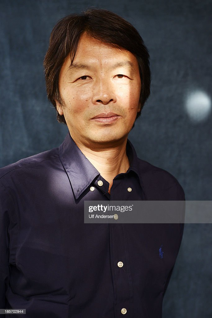 Chinese writer Liu Zhenyum poses during a portrait session held on October 22, 2013 in Paris, France.