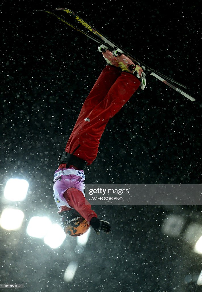 Chinese Xin Zhang competes during Ladies' FreeStyle Aerials final race at the Snowboarding and Free Style World Cup Test Event at the Snowboard and Free Style Centre in Rosa Khutor near the Russian Black Sea resort of Sochi on February 17, 2013. Chinese Mengtao Xu won the race ahead of Australian Laura Peel and Swiss Tanja Schaerer.