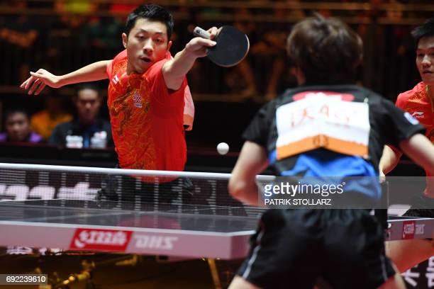 Chinese Xu Xin and Fan Zhendong play against Japanese Masataka Morizono and Yuya Oshima during men´s doubles final of the WTTC World Table Tennis...
