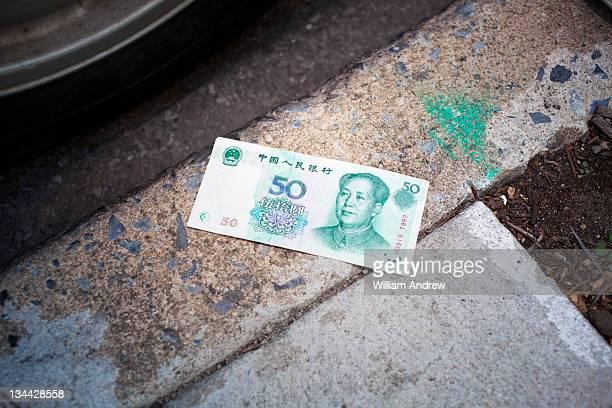 Chinese Yaun lost on sidewalk