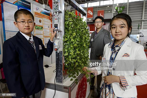 Chinese young inventors Fan Xiyu Li Peize and Wang Yifan from Beijing 101 Middle School present on April 2 2014 their creationan intelligent new...