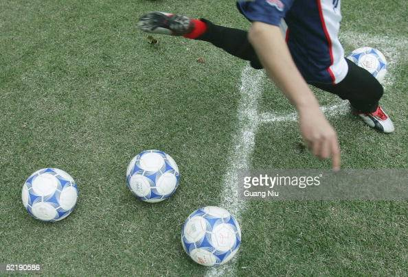 Chinese young soccer player practises a corner ball during a training course on February 11 2005 in Qingyuan Guangdong province China More than one...