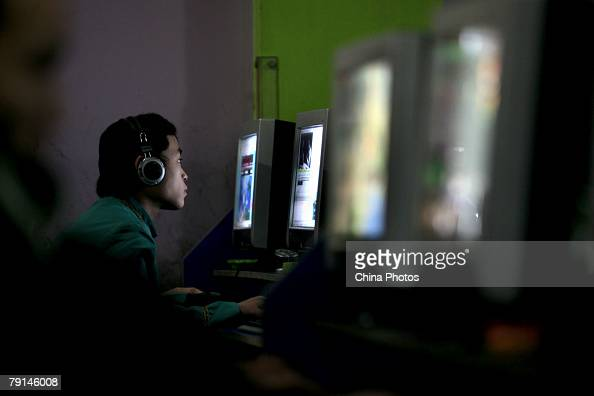 A Chinese youth plays online game in a net cafe on January 21 2008 in Chongqing Municipality China According to the China Internet Network...