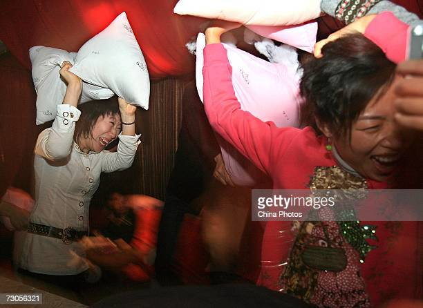 Chinese youths playfully beat each other with pillows during a 'Pillow Party' at a bar on January 20 2007 in Shanghai China Over 100 Chinese youths...