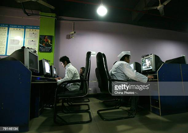Chinese youths surf the internet in a net cafe on January 21 2008 in Chongqing Municipality China According to the China Internet Network Information...