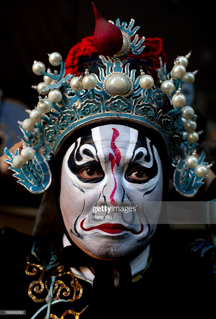 A Chinese Yu Opera performer dresses up to prepare for the performance on October 30, 2012 in Zhengzhou, China. As many as 60 performers from the Sanmenxia theatrical troupe are invited to perform Chinese traditional Yu Opera for local villagers in rural Zhengzhou city to celebrate the village's temple fair and earn 10,000 RMB yuan (US$ 1,600) each performance. Yu Opera, also called Henan Bangzi or Ou Opera, is one of the most popular local operas in China. Its earliest written record can be traced back more than 200 years and at the end of the Qing Dynasty (A.D. 1644-1911), the opera became widespread across the Henan province. After the establishment of the People's Republic of China in 1949, it experienced rapid growth not only in the villages and cities of Henan Province but also throughout the country. In recent years its popularity has declined due to young people's attraction to more modern cultures.