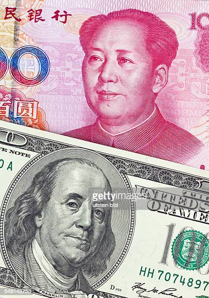 Chinese Yuan Renminbi and Dollar banknotes with portraits of Mao Zedong and Benjamin Franklin