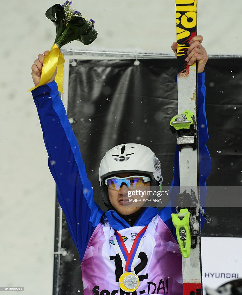 Chinese Zhongqing Liu celebrates on podium after the Men's FreeStyle Aerials final race at the Snowboarding and Free Style World Cup Test Event at the Snowboard and Free Style Centre in Rosa Khutor near the Russian Black Sea resort of Sochi on February 17, 2013.Chinese Guangpu Qi won the race ahead of Chinese Zhongqing Liu and Belorussian Denis Osipau.