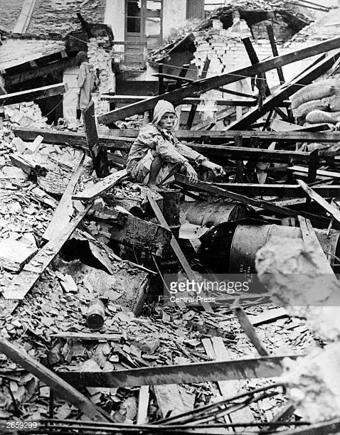 A Chineseborn shopkeeper sitting in the wreckage of his home in the ancient city of Hue after its recapture by US and South Vietnamese forces during...