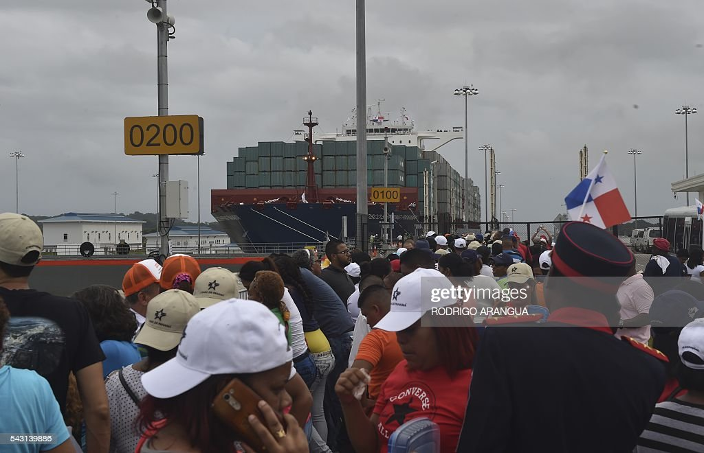 Chinese merchant ship Cosco Shipping Panama crosses the new Cocoli Locks during a inauguration at the Panama Canal on June 26, 2016. A giant Chinese-chartered freighter nudged its way into the expanded Panama Canal on Sunday to mark the completion of nearly a decade of work forecast to boost global trade. / AFP / RODRIGO