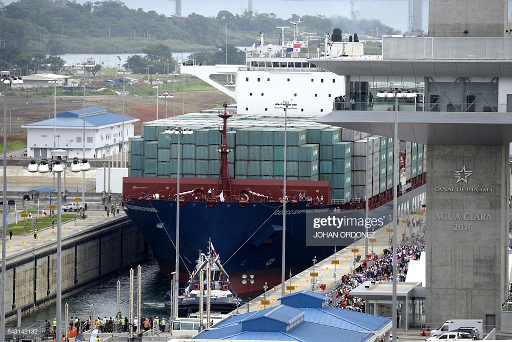 Chinese-chartered merchant ship Cosco Shipping Panama crosses the new Agua Clara Locks during the inauguration of the expansion of the Panama Canal in Colon, 80 km from Panama City on June 26, 2016 on June 26, 2016. A giant Chinese-chartered freighter nudged its way into the expanded Panama Canal on Sunday to mark the completion of nearly a decade of work forecast to boost global trade. / AFP / JOHAN